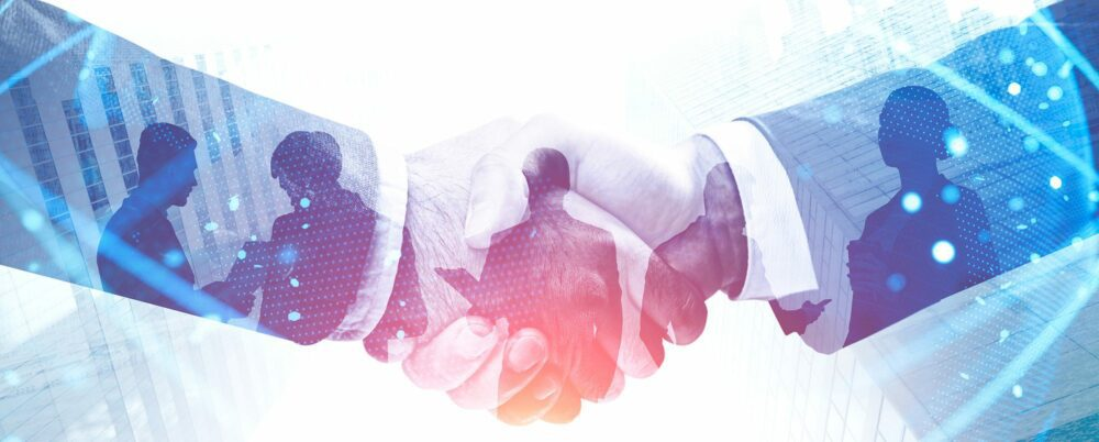 Handshake in city. Double exposure of planet hologram. International business partnership concept and hi tech. Toned image